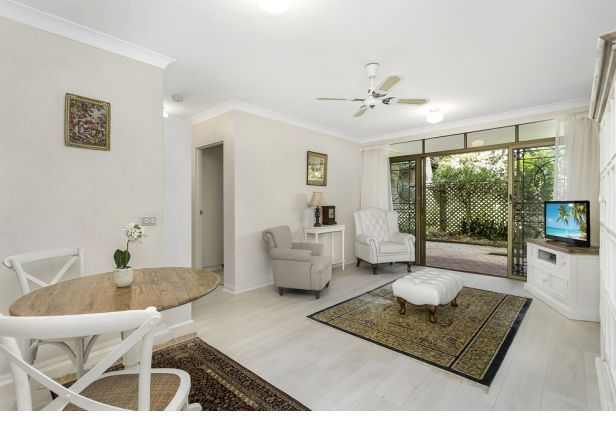 Garden apartment in highly sought-after over 55s complex